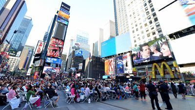 Punters gather in New York's Times Square to watch the live broadcast. (Getty)