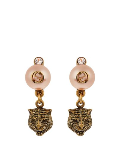 "Gucci pearl effect earrings $345 at <a href=""http://www.matchesfashion.com/au/products/Gucci-Pearl-effect-embellished-tiger-earrings-1074248"" target=""_blank"">Matches</a>"