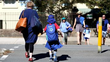 A mother and her child outside Annandale Public School in Sydney's Inner West