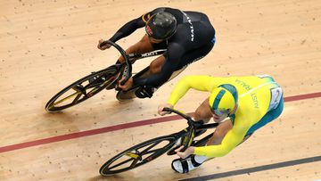 Glaetzer of Australia and Muhammad Shah Firdaus Sahrom of Malaysia during the men's sprint qualifying event. (AAP)
