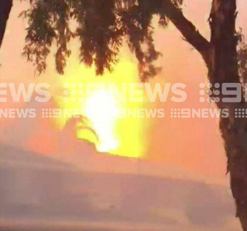 Witnesses filmed the blaze while fleeing. (9NEWS)