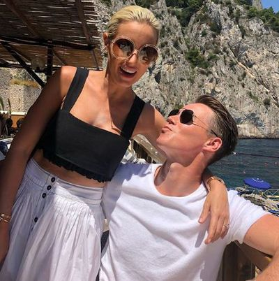 Roxy Jacenko in a pair of Gucci sunglasses with husband Oliver Curtis in Capri Italy