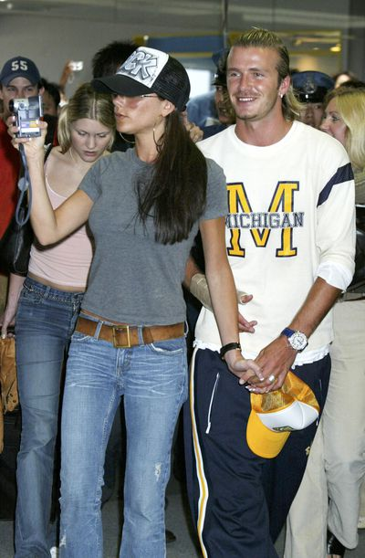 <p><strong>Sporty Spice</strong></p> <p>Victoria and David walk through New Tokyo International Airport on June 22, 2003.</p>