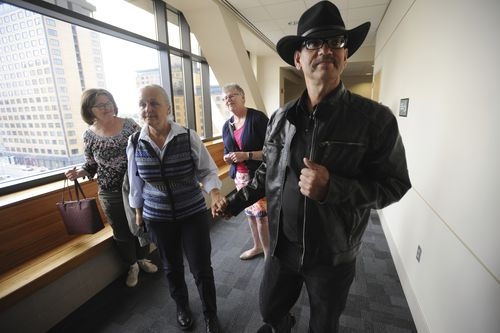 Timothy Hoffman, right, father of slain teenager Cynthia Hoffman receives support from Edie Grunwald, left, who's son David Grunwald was murdered in November.  (Bill Roth/Anchorage Daily News via AP)