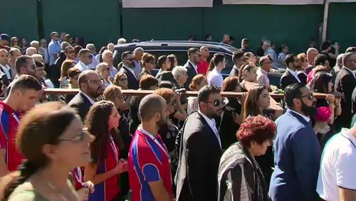 A parade follows the Stations of the Cross in Sydney. (9NEWS)