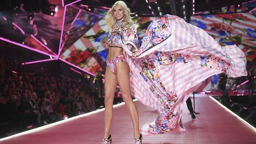 FILE- In this Nov. 8, 2018, file photo model Devon Windsor walks the runway during the 2018 Victoria's Secret Fashion Show at Pier 94 in New York. Victoria's Secret's owner, L Brands, said that the private-equity firm Sycamore Brands will buy 55% of Victoria's Secret for about $525 million. Victoria's Secret will become a private company.