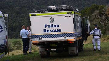 Rescue teams had to enter on foot to reach the crash site where a father and son's bodies were recovered.
