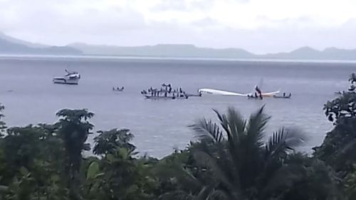 The plane in the ocean after overshooting the runway in Micronesia close to Papua New Guinea.