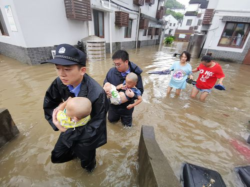 Chinese rescuers evacuate babies in floodwater after heavy rainstorm caused by Typhoon Lekima.