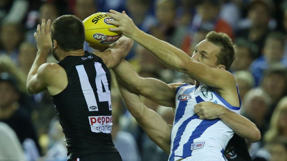 Drew Petrie marks in his 300th game. (Getty)