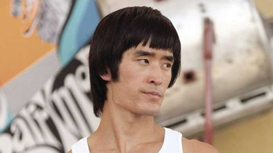 Mike Moh as Bruce Lee.