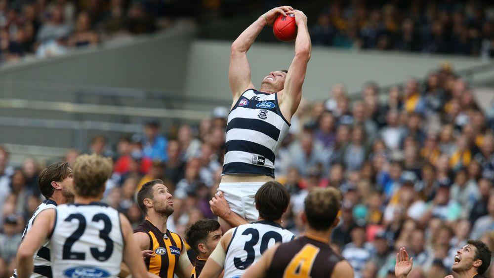 Dangerfield stars as Cats hold out Hawks