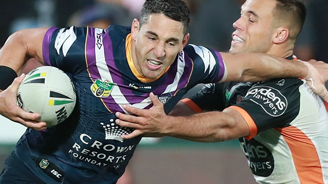 Billy Slater of the Storm is tackled by Luke Brooks of the Wests Tigers during the Round 5 NRL match between the Wests Tigers and the Melbourne Storm at Mt Smart Stadium in Auckland, New Zealand, Saturday, April 7, 2018.