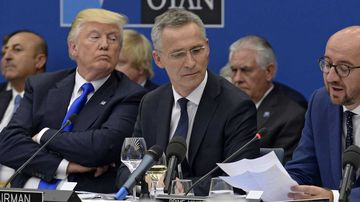 Donald Trump listens to the prime minister of Belgium during a NATO summit in Brussels. (AAP)