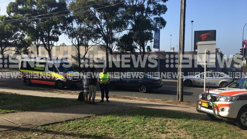 Police interview the driver at the scene after an accident in Bankstown left a boy injured. Picture: 9News