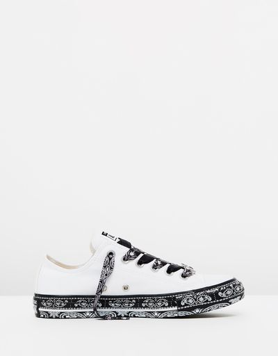 "<a href=""https://www.theiconic.com.au/converse-x-miley-chuck-taylor-all-star-classic-632665.html"" target=""_blank"">Converse X Miley Chuck Taylor All Star Classic in White, $120</a>"