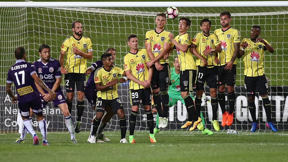 Diego Castro launches a free-kick over the Wellington wall. (AAP)