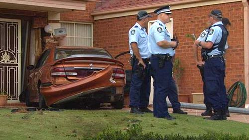 Men charged after car crashes into home