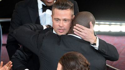 Actor/producer Brad Pitt embraced 12 Years a Slave director Steve McQueen after the film won the Best Picture award.