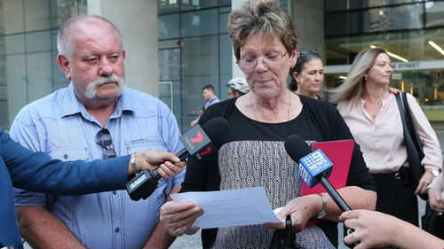 Peter and Julie Spencer speak to the media outside the Brisbane Supreme court. (AAP)