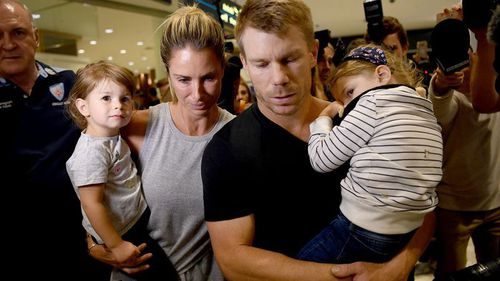 Warner, wife Candice and their children were swarmed by reporters upon arrival in Sydney last month. (AAP)
