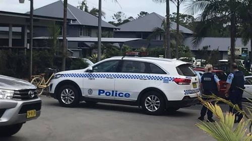 Police raided the motel near Byron Bay in the hunt for the two men.