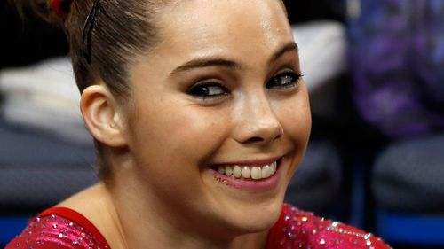 McKayla Maroney smiles after competing on the floor exercise during the US women's national gymnastics championships in 2013. (AAP)