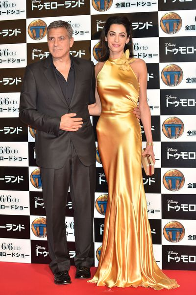 George and Amal Clooney, in a custom Maison Margiela dress by John Galliano dress at the  Tokyo premiere of Tomorrowland in May, 2015