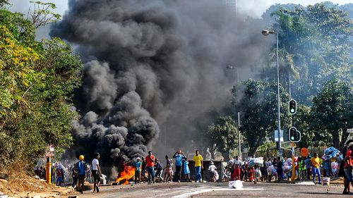 South Africa's President Cyril Ramaphosa warned that continued protests and looting could further undermine the nation's Covid-19 response and vaccination rollout.