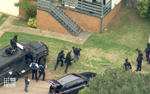 Two arrested after four-hour siege in Sydney