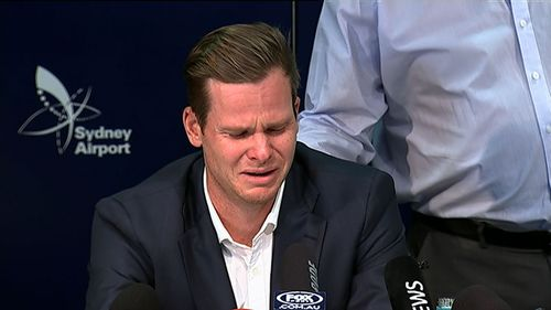 Steve Smith's father puts a comforting hand on his son's back during his raw press conference last night. Picture: 9News