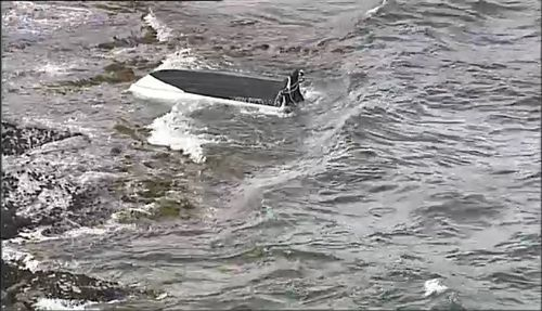 A 47-year-old man has died after a small boat he and two others was in capsized in Sydney's south today. Picture: 9NEWS.
