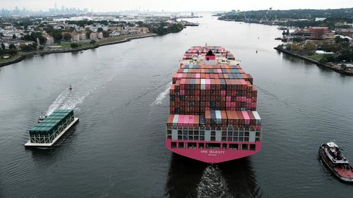 A cargo ship moves under the Bayonne Bridge as it heads out to the ocean in Bayonne, New Jersey.