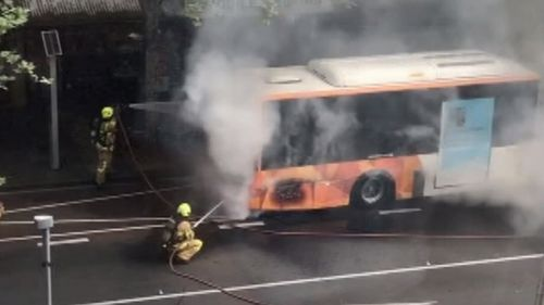 Smoke was shown billowing from the bus.