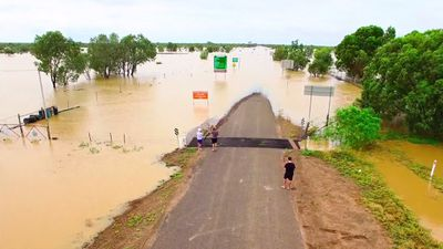 <p>People have surveyed the flooding, which has closed most major roads. </p><p>(Supplied / Nick McGrath, Winton Shire Council)</p>