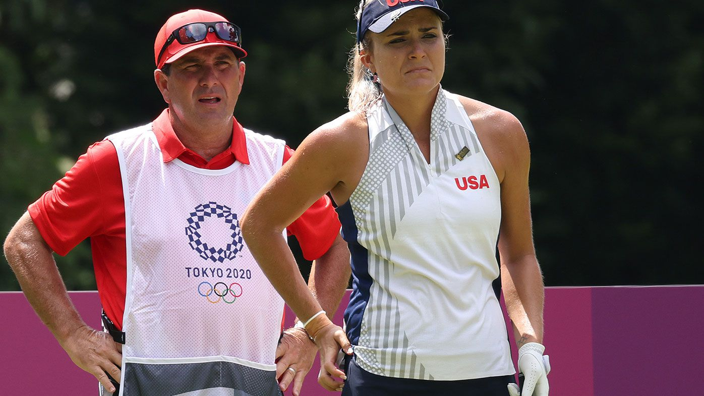 Lexi Thompson of Team United States and and caddie Jack Fulghum, before Fulghum was replaced late in the first round of the Tokyo Olympics.