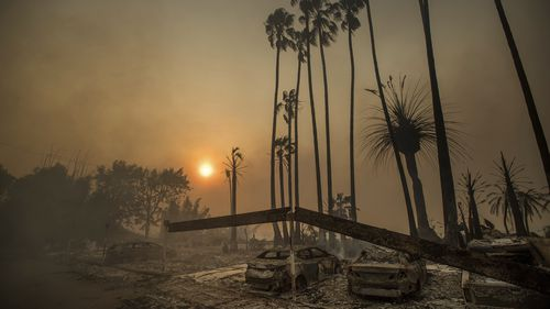 The wildfires burned through a large land mass in December, levelling an apartment complex in Ventura. (AAP)
