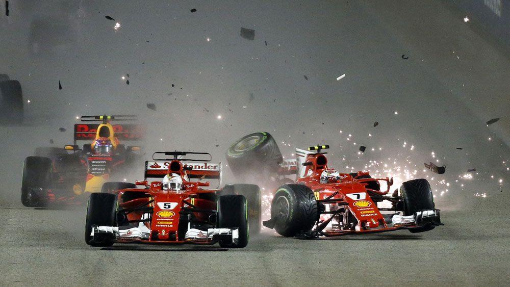 Ferrari's Sebastian Vettel out of Singapore Grand Prix after spectacular first corner crash
