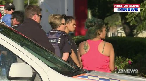 Nine people were arrested in the carpark of a fast food outlet. (9NEWS)