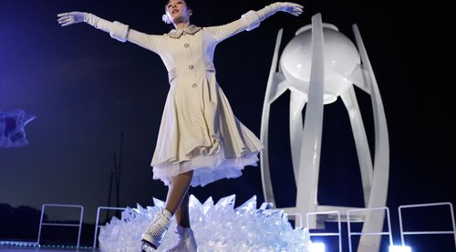 South Korean Olympic figure skating champion Yuna Kim performs before lighting the Olympic flame. (AAP)