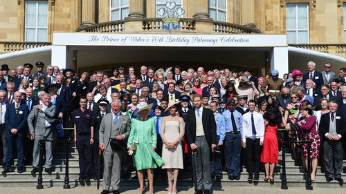 Prince Charles, Camilla, Meghan and Prince Harry pose with the guests. (PA/AAP)