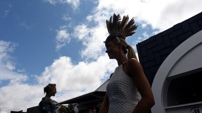 Blue sky appears over the Birdcage on Oaks Day. (AAP)