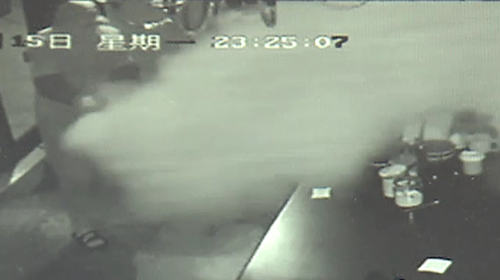 The intruder was seen on security camera spraying a fire extinguisher in the cafe.