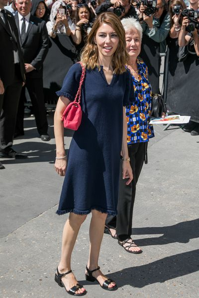 An understated Sofia Coppola in a simple Chanel tunic at the Chanel haute couture show, Paris.