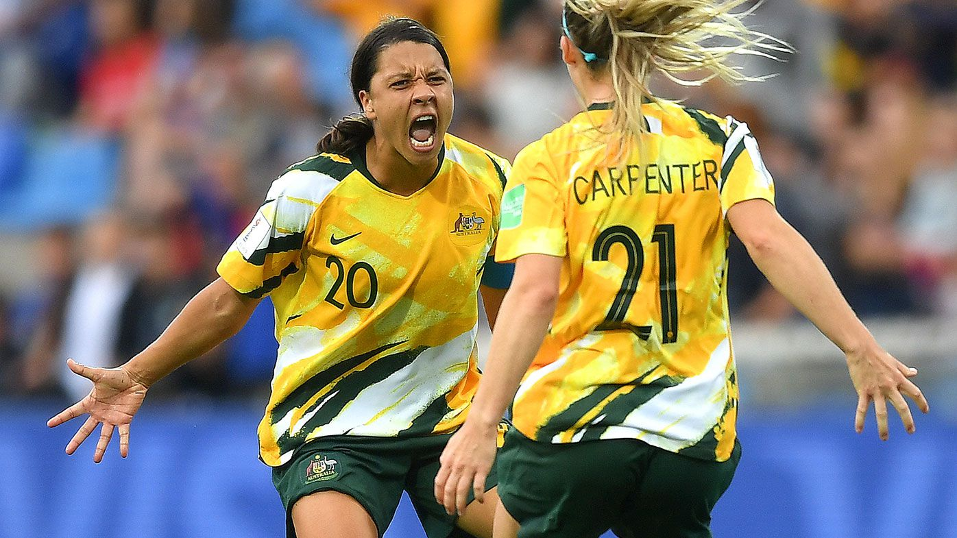 Sam Kerr and Ellie Carpenter celebrate after Australia defeated Brazil at the World Cup.