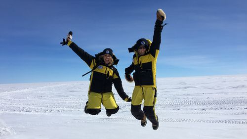 TODAY Melbourne Reporter Christine Ahern enjoys a jubilant leap at the Antarctic Circle. (9NEWS)