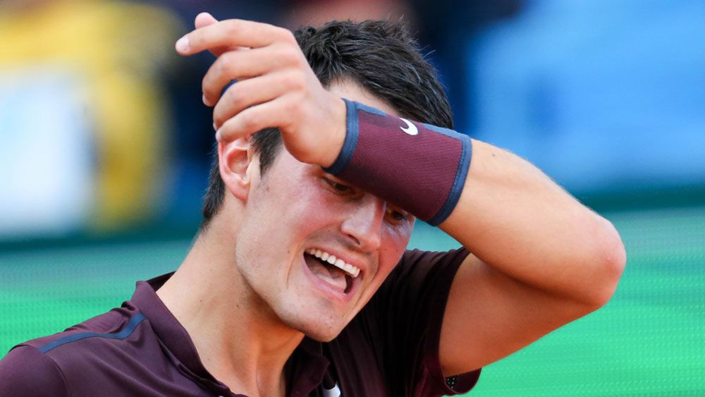Tomic retires eight minutes into match