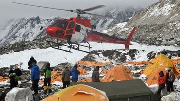 A helicopter prepares to land at the Mount Everest base camp. (Getty)
