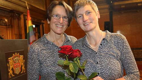Newly wed Marion (L) and Undine Maria Eggers smile after their civil ceremony. (AAP)