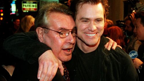 """Jim Carrey, star of Forman's """"Man on the Moon,"""" embraces the director at the film's premiere in 1999. (AP)"""
